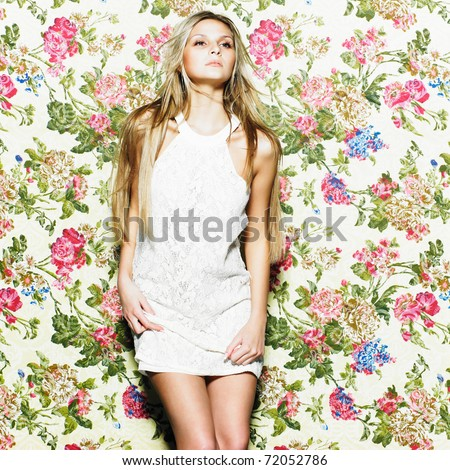 Beautiful woman with elegant white dress. Fashion photo