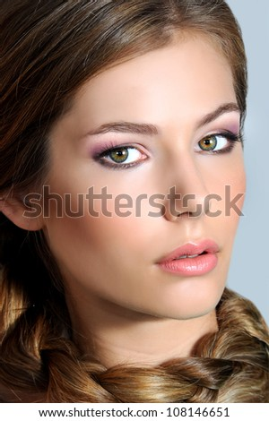 Beautiful woman with evening make-up and stylish hairstyle