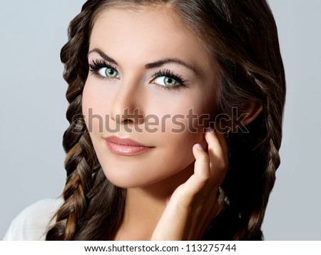 Beautiful woman with evening make-up and stylish hairstyle.Bride