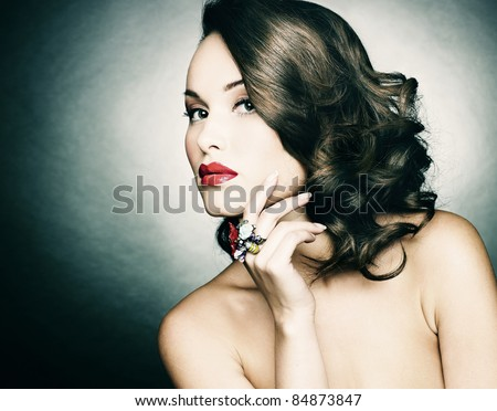 Beautiful woman with evening make-up. Retro style. Fashion photo