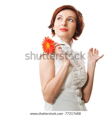 Beautiful woman with flower gerber in her hands against white background
