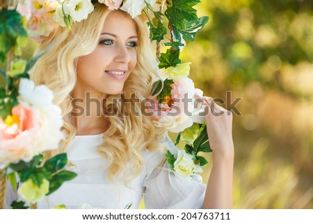 Beautiful woman with flower wreath.Beautiful women in the countryside.Portrait of beautiful young girl outdoors in spring