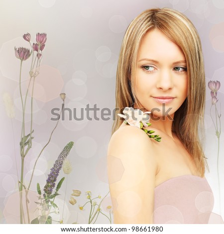Beautiful woman with flowers - fantasy background