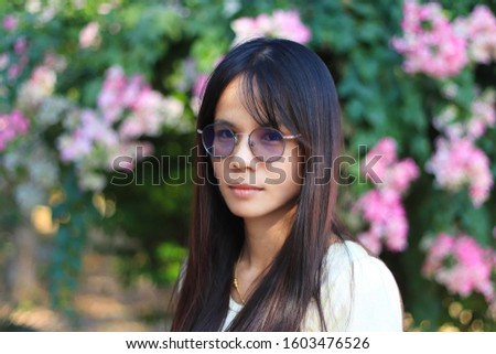 Beautiful Woman with Flowers of  Summer Beautiful Lady with Healthy and Beauty Hair