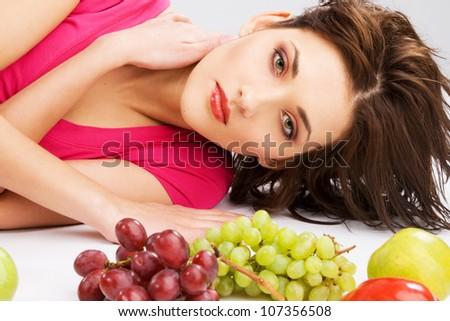 Beautiful woman with fresh fruits