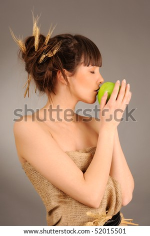 Beautiful woman with fresh green apple. Eco concept.