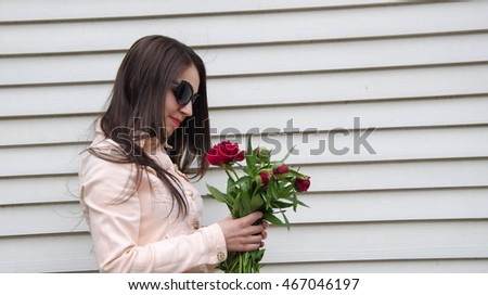 Beautiful  woman with fresh health skin of face and red flower #467046197