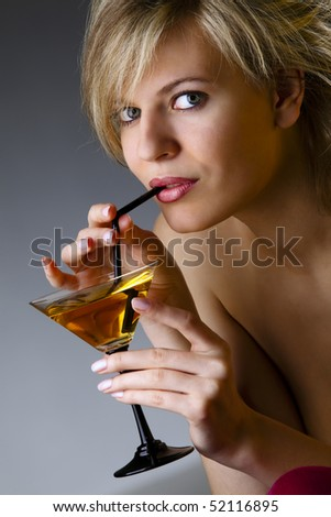 Beautiful woman with glass of cocktail