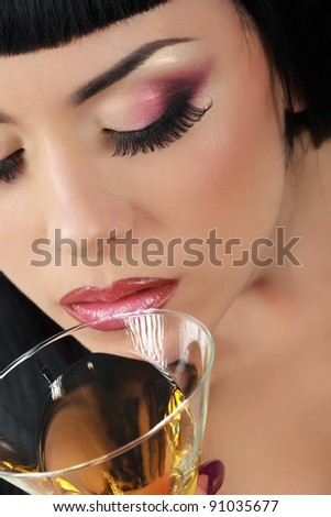 Beautiful woman with glass of cocktail.Top view