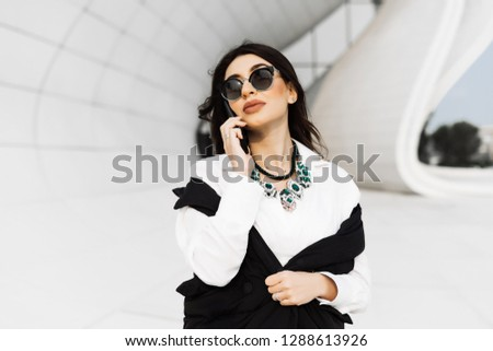 beautiful woman with glasses on the phone