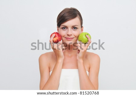 Beautiful woman with green and red apples