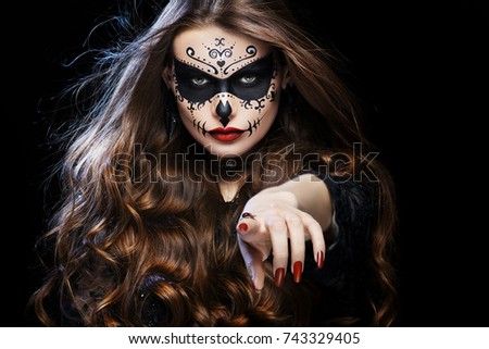 beautiful woman with halloween sugar skull makeup pointing her finger at you i want you