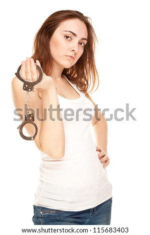 Beautiful woman with handcuffs isolated on white