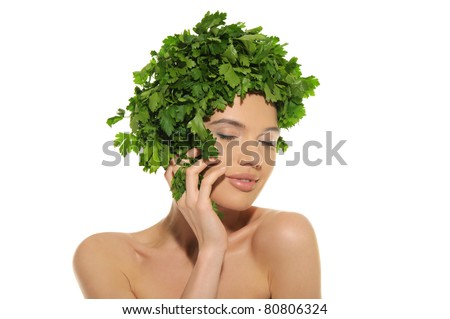 beautiful woman with hat of parsley isolated on white