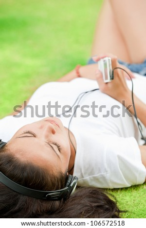 Beautiful woman with headphones listening to music