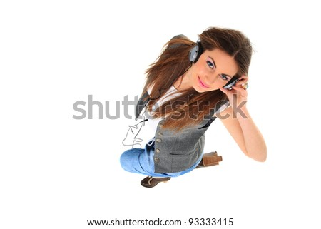 Beautiful woman with headphones, she is listen to the music top view