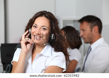 Beautiful woman with headset on - stock photo