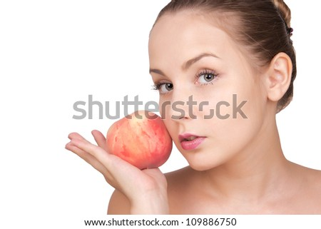 Beautiful woman with healthy clean face skin holding peach isolated on white background. Spa skin care cute girl
