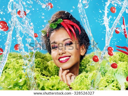 Beautiful woman with healthy food and water splashes