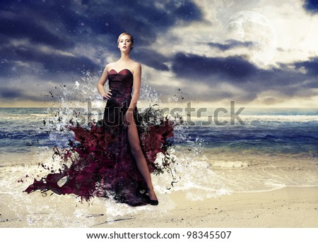 Beautiful woman with her evening gown melting away with seascape in the background