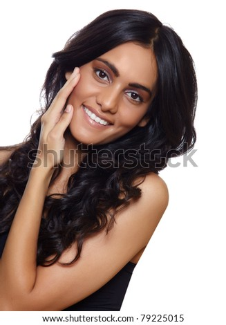 beautiful woman with long black curly hair, tanned skin and natural make-up over white background.