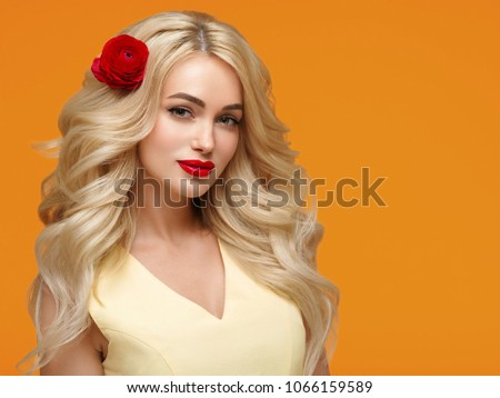 Beautiful woman with long blonde hair and red lips, colorful emotional female portrait with beauty makeup and healthy hair #1066159589