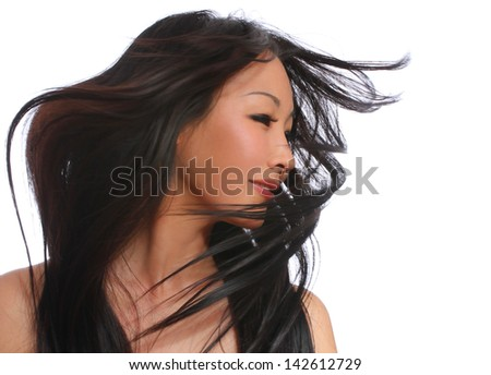Beautiful woman with long brown flying hair. portrait of a fashion model