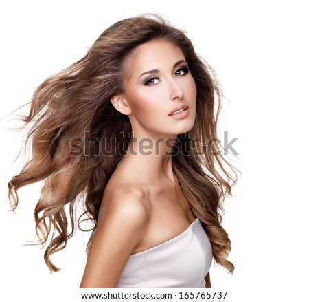Beautiful woman with long brown hair in movement and makeup. Isolated on white