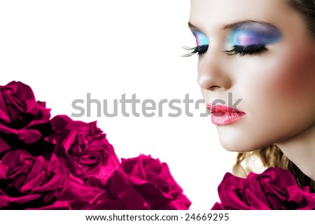 Beautiful woman with long false lashes and bright make-up on red rose background ? shallow DOF, focus on the face