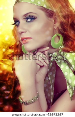 beautiful woman with long hair and green polka dot scarf with disco lights