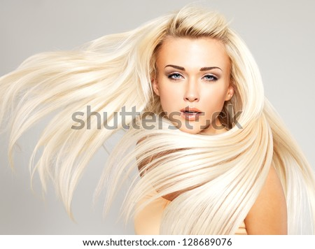 Beautiful woman with long straight blond hair. Fashion model posing at studio. #128689076
