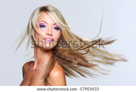Beautiful woman with long straight hair and multi colored makeup