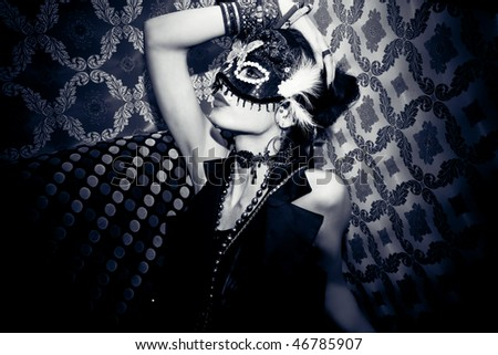 beautiful woman with mask in night club