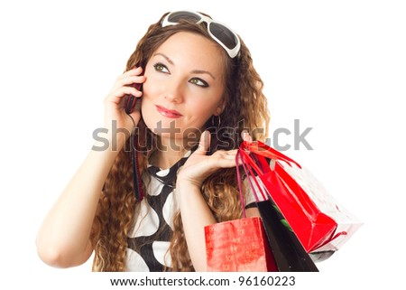 Beautiful woman with packages shopping and mobile phone on white background.