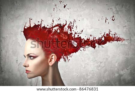 Beautiful woman with paint instead of her hair