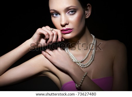 Beautiful woman with pearl jewelry