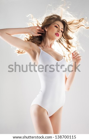 beautiful woman with perfect body dressed in white body-wear