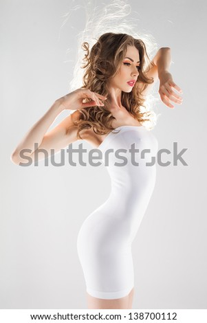 beautiful woman with perfect body dressed in white modeling dress