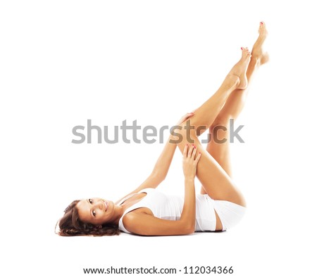 Beautiful woman with perfect body lying on white background