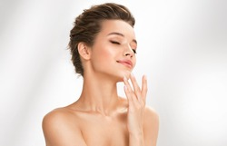 Beautiful woman with perfect makeup on white background. Beauty and skin care concept