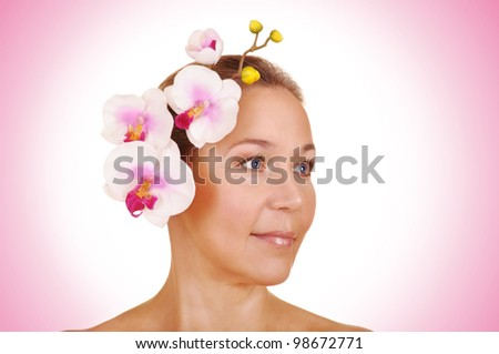 beautiful woman with pink flower - stock photo