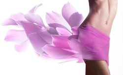 Beautiful woman with pink petals  on her hips
