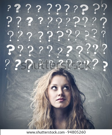 stock photo : Beautiful woman with questioning expression and question marks above her head