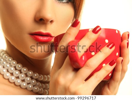 beautiful woman with red cup