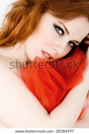 Beautiful woman with red hair and blue eyes