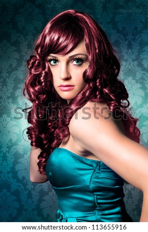 beautiful woman with red hair and evening-dress