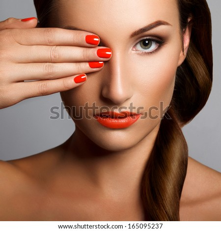 Beautiful Woman With Red Nails Makeup and Manicure Red Lips