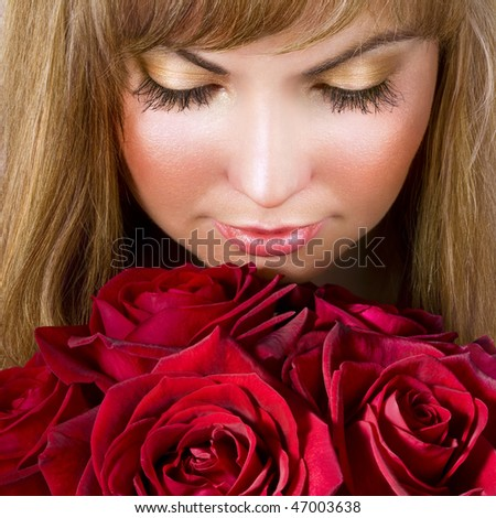 Beautiful woman with red roses