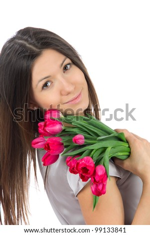 Beautiful woman with red tulips bouquet of flowers smiling isolated on white background