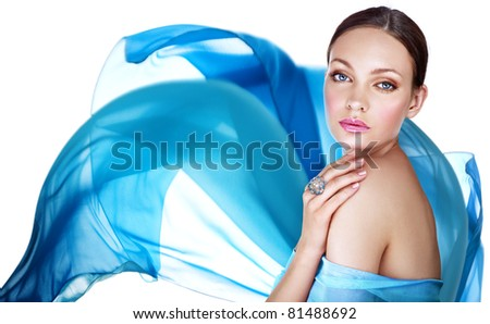 Beautiful woman with ring and blue color scarf - stock photo